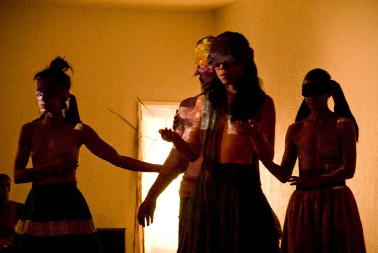 Circle of women blindfolded