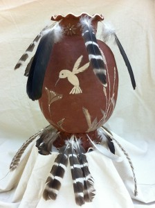 Clay vessel with feathers- Hawk, vulture, turkey and pheasant.  By Liz Boubion and Sculptor, Meryl Juniper